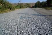 FOTO - Lucrări de tratament dublu bituminos demarate pe drumul judeţean DJ 109C Geaca–Sucutard-Ţaga