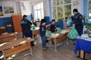 FOTO/VIDEO - Polițiștii din Beliș, exemplu de AȘA DA! Au strâns bani și au oferit cadouri elevilor din comună